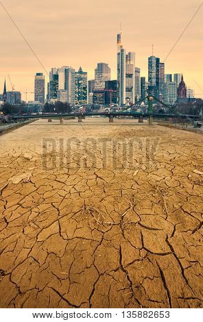 modern city and desolate cracked earth landscape