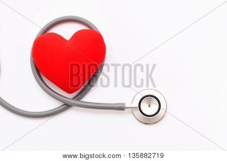 Heart with stethoscope on white background, heart healthy concept