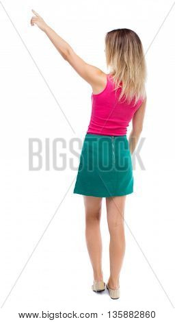 Back view of  pointing woman. beautiful girl. Rear view people collection.  backside view of person.  Isolated over white background.  Girl in a green skirt shows the right hand to the sky.