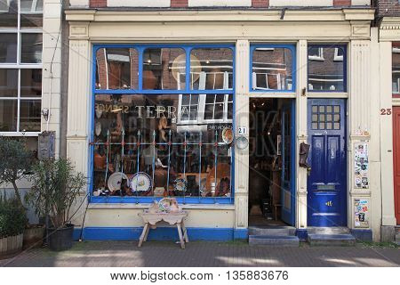 AMSTERDAM, NETHERLANDS - MAY 8, 2016: Facade of vintage shop in Amsterdam, Netherlands. The Nine Streets - special neighbourhood is full with vintage and designer shopping speciality stores and cozy cafes