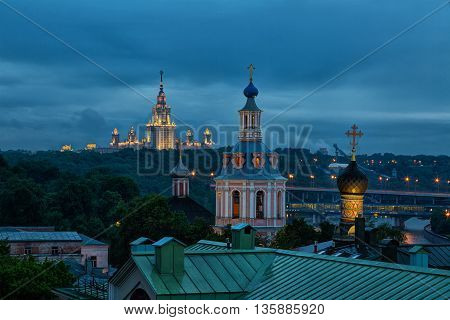 View to the observation deck of the Russian Academy of Sciences at the University of Moscow and St. Andrew's Monastery at night Russia