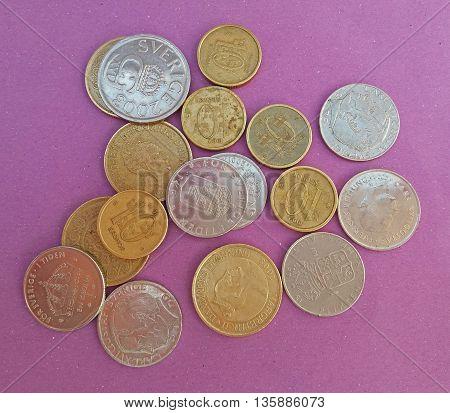 Swedish krona SEK and Danish krone DKK coins over violet background