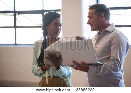 Two business people having a discussion in office