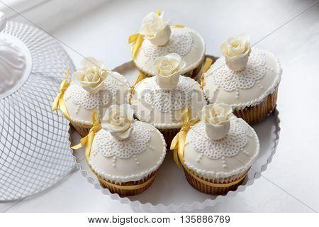 Beautiful wedding white cake close up .