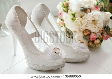 wedding rings boutonniere bouquet and bridesmaid shoes.