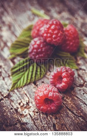 Fresh raspberry on a ancient wooden table