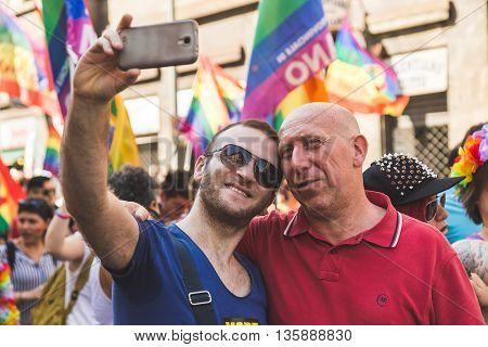 MILAN ITALY - JUNE 25: People at Pride parade in Milan JUNE 25 2016. Thousands of people march in the city streets for the annual Pride parade claiming equality and legal rights.
