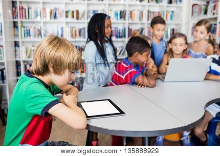 Pupils using technology in library