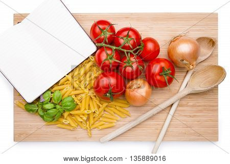 Groceries and noodles on a wooden cutting board