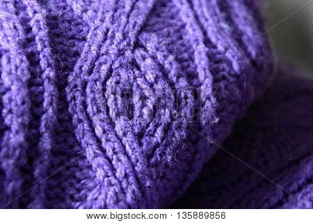 Handmade purple knitting pullover wool texture background