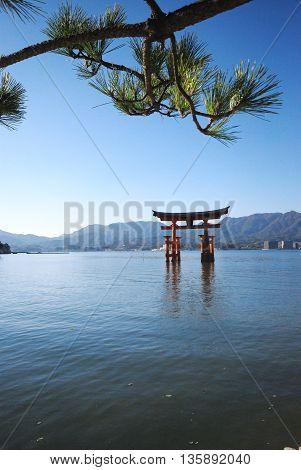 The great torii, red shrine in the sea. A famous landmark in Miyajima island, Japan.