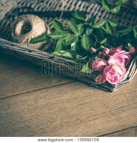 Rose Flowers With Yarn Ball In Wicker Basket