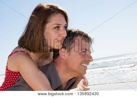 Caucasian Man Having His Woman Piggyback On His Back