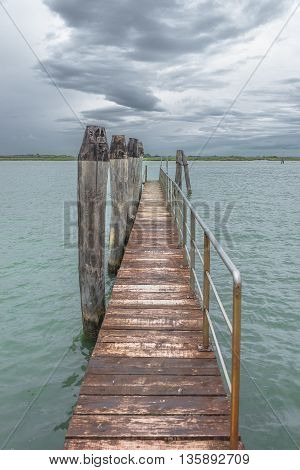 Wooden Old Pier At Burano, An Island Nearby Venice, Italy