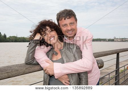 Happy Couple At The River Cuddling And Have Fun