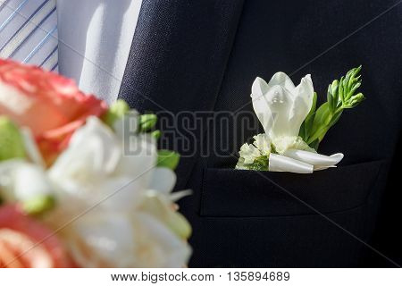 jacket of the groom and a beautiful boutonniere