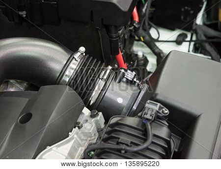 Details of a new car engine and attachments