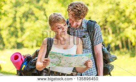 Hiking Backpacking Couple Reading Map On Trip.