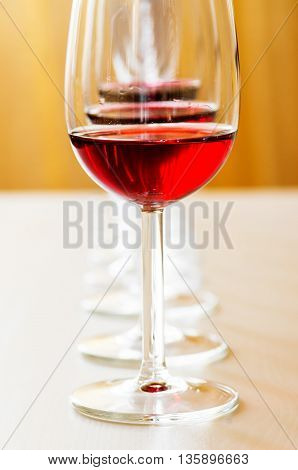 Red wine tasting on the table in a line