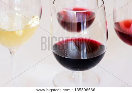 Wine by the glass on the table closeup