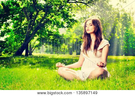 Young Woman Doing Yoga In Spring Park. Leisure Time Activity Concept