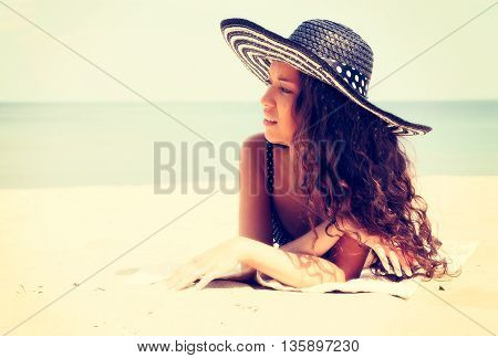 Young Woman In Bikini Lying Down And Sunbathing On The Beach. Vacation And Travel Concept.