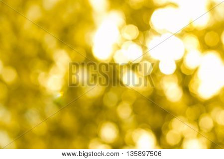Beautiful sparkling abstract golden bokeh background defocused