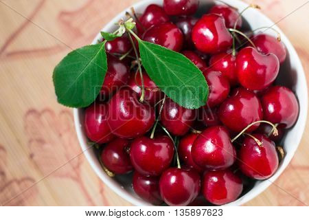 Ripe sweet red cherries in a bowl