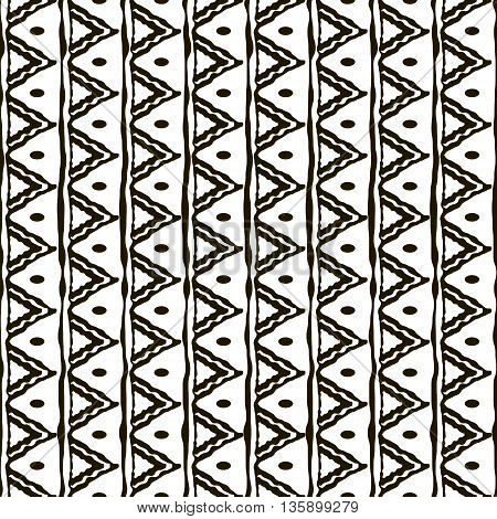Seamless black and white pattern with ethnic motifs. Vertical stripes triangular shapes and small ovals. Abstract geometric ornament in hand drawing style. Vector illustration for creative design