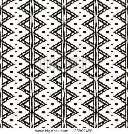 Seamless black and white pattern with ethnic motifs. Vertical stripes, triangular and circular shapes. Abstract geometric ornament in hand drawing style. Vector illustration for modern design