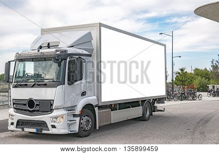 A blank bilboard on the side of a white truck customizable for your advertising needs.