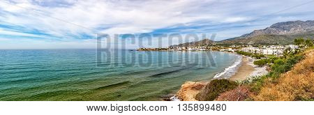 A panoramic view of one of the beaches by cliffs at Makrygialos on the Greek island of Crete.
