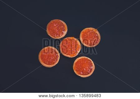 Vintage style: Round tartlets with russian red caviar
