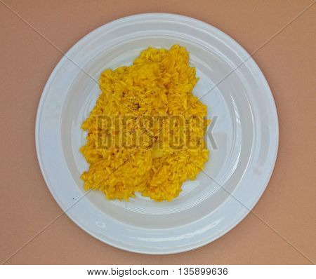 Saffron risotto made with Carnaroli rice medium grained rice grown