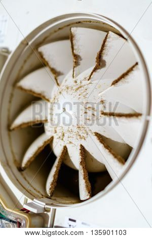 Built-in exhaust fan. Dirty dusty fan. Shallow depth of field.