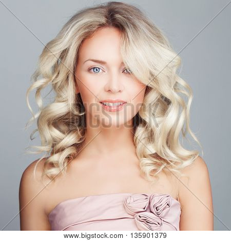Glamorous Fashion Model. Blonde Woman Posing on gray