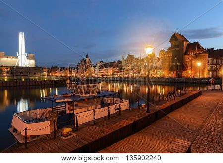 Scenery with boats in old town of Gdansk in the evening Poland Europe