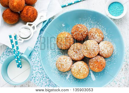 Donuts for breakfast with milk top view