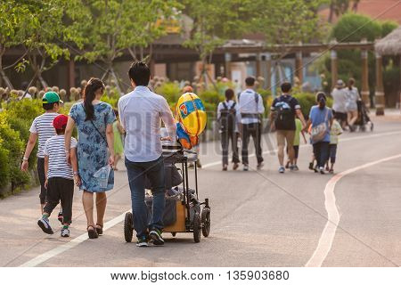 Seoul South Korea - June 13 2016 : Big asian family walking away from the behind in park.