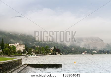 Fog comes down from the mountains to the town of Stresa on Lake Maggiore in the spring.