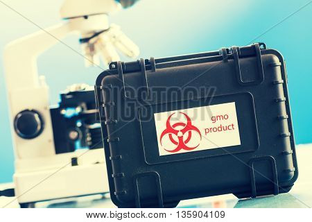 Safe case with GMO product and microscope in laboratory