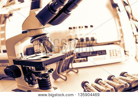 microscope in medical laboratory.  Toned image