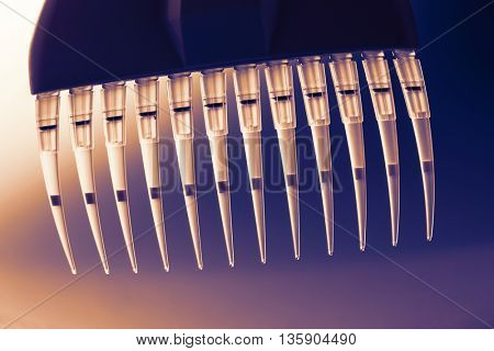 multi pipette for genetic researchings.  Toned image