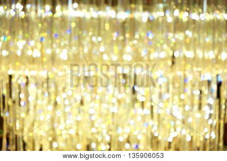 Blurred image of big beautiful chandelier with bright lighting.