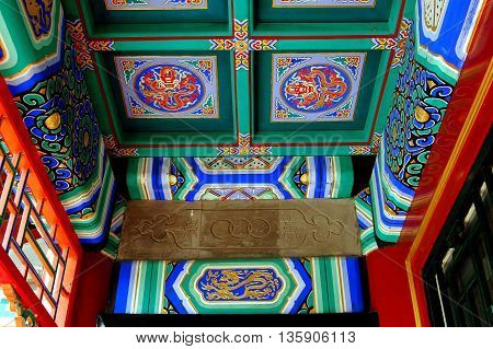 Beijing China - May 5 2005: Hand-painted wooden ceiling at the Wenchang Gallery in traditional red green and blue colours at the Summer Royal Palace