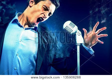 Young handsome man singing. Image with a digital effects