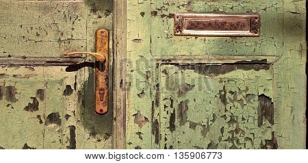 Banner of an old cracked wooden door with handle - closeup