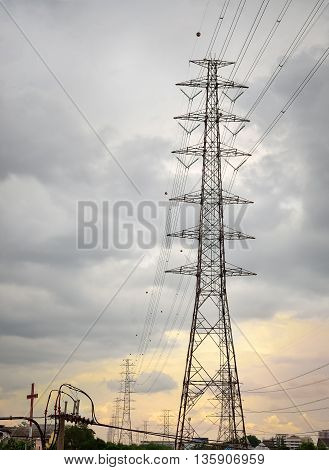 High voltage tower and cable line with rain clouds in morning sky, Bangkok, Thailand (light, sky, morning)