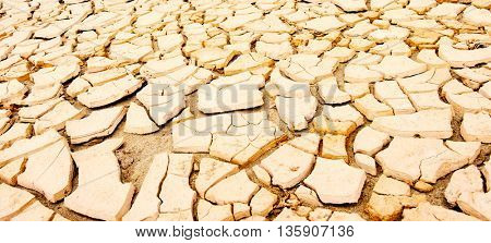 cracked soil during drought. Toned image