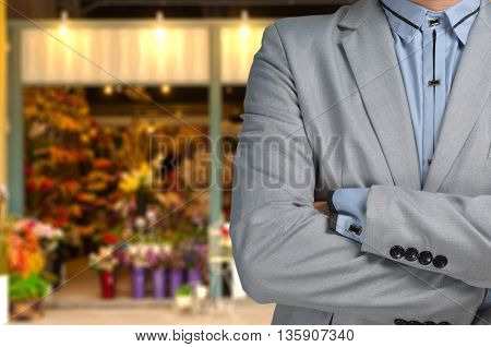 Businessman as Florist standing in front of Flower or Floral Shop Small business owner or Entrepreneur Concept